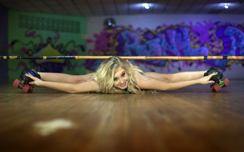 Kaitlyn Conner, 19, poses for a portrait at the Rink Ratz roller skating rink owned by her mother, Victoria Conner