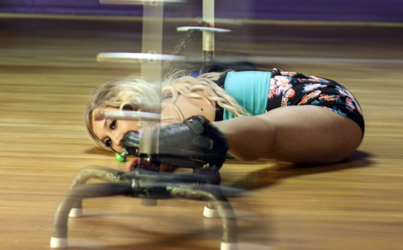 Kaitlyn Conner can glide under a limbo on SKATES while doing the SPLITS.