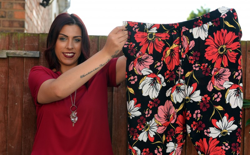 Chelsea Stevens, 25, from, Yardley, Birmingham shows off her old size twenty four trousers