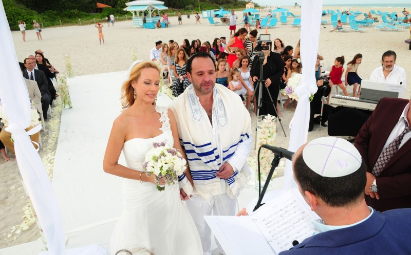 Gustavo Bogomolni, 45 and Fanny Perez, 39 at their real wedding on Miami beach in Miami, florida, USA in february 2014
