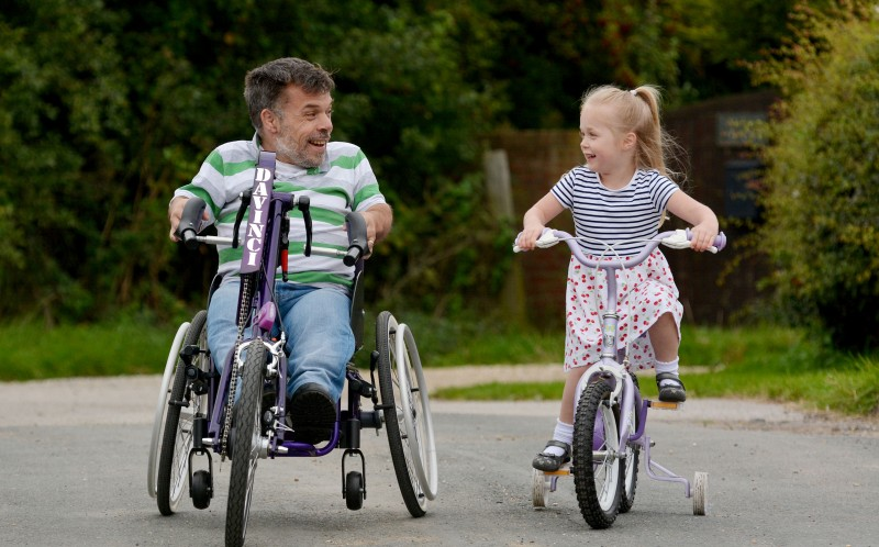 Rich Willis learns to walk with daughter, Cherry, 4