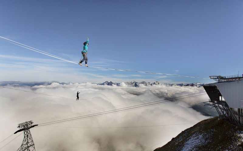 Two girls above the clouds on the top of Moleson, one on a 90m-long rope and the other on a 120m