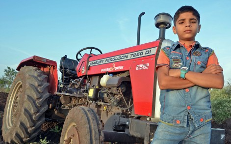 PIC BY UDAY DEOLEKAR/ CATERS NEWS - (PICTURED: Ratanjith Patil  with his tractor) - An Indian schoolboy is leaving spectators in awe of his jaw-dropping stunts with a tractor. Ratanjith Patil is just ten-years-old but at the age when he is expected to play cricket or football with his friends, he plays with a tractor in the yard of his home. The pint-sized lad, a student of sixth standard, is a master behind the wheels of the farm machine and performs daredevil stunts such as wheelies and drifts. Shockingly, he doesnt wear safety gear while displaying his nail-biting acts in land surrounding his home in Sangli, Maharashtra in western Indian. SEE CATERS COPY.