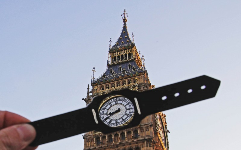 A PAPER CUT OUT OF A WATCH IN FRONT OF BIG BEN