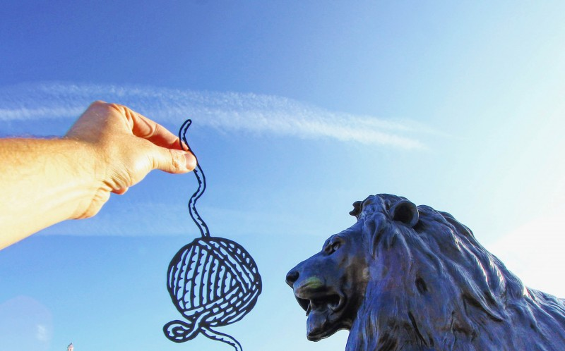 A PAPER CUT OUT OF A BALL OF WOOL BY THE TRAFALGAR SQUARE LIONS