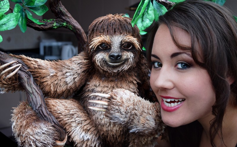 VICKI SMITH, 27, WITH HER SLOTH CAKE