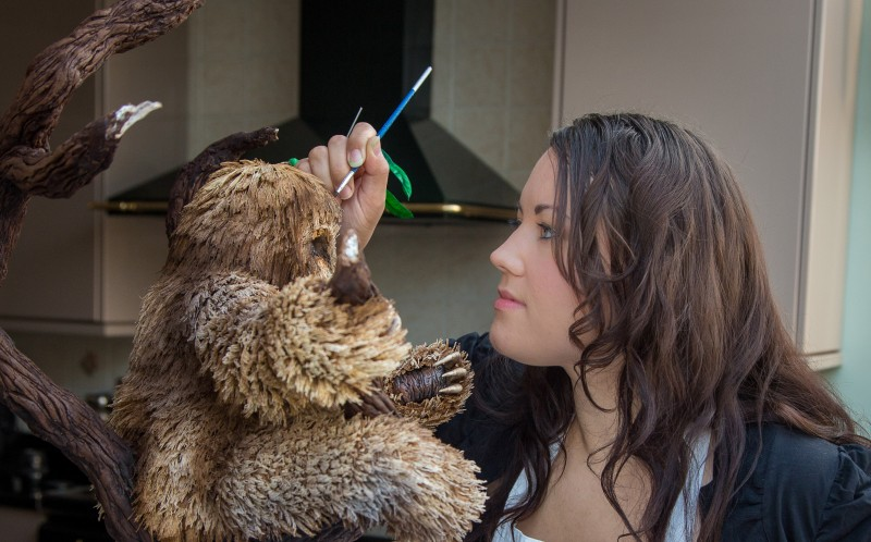 VICKI SMITH, 27, MAKING SOME FINAL TOUCHES TO HER SLOTH CAKE