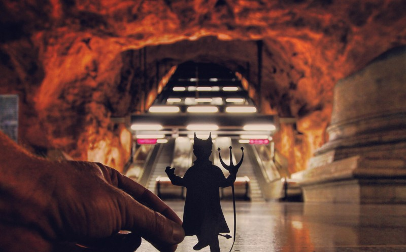 A PAPER CUT OUT OF A DEVIL IN THE STOCKHOLM METRO