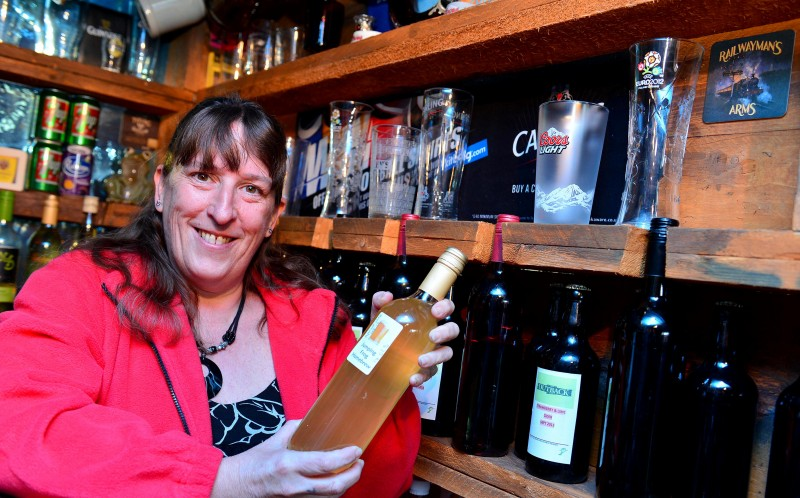 Helen is pictured with some of her home brewed wine