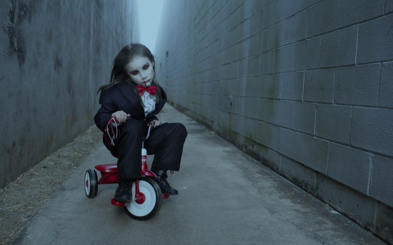 A CHILD DRESSED AS JIGSAW FROM THE MOVIE SAW