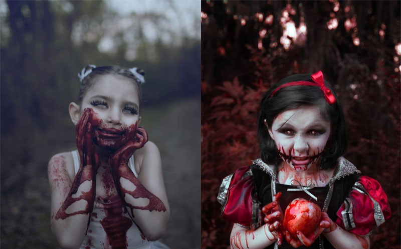 A CHILD DRESSED AS VAMPIRE LEFT AND SNOW WHITE RIGHT