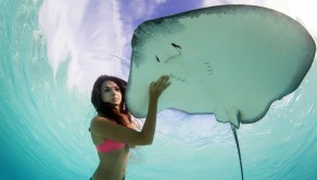 PIC FROM CATERS NEWS - (PICTURED: A beautiful model swimming with a stingray in Tahiti ) - These stunning images show mermaid-like models swimming through the ocean with deadly STINGRAYS. Taken in beautiful Moorea, off the north-west coast of Tahiti, the real-life mermaids swim through the beautiful clear blue lagoon with their fishy friends. Snapped by French photographer Chris, the incredible pictures show the models gliding through the crystal-clear water as they strike a pose with the stingrays. SEE CATERS COPY.