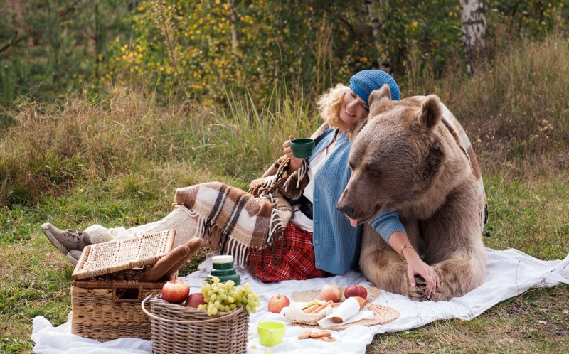 The model simply known as Irina enjoys a picnic with a real life teddy bear