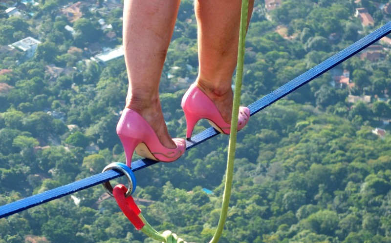 Faith's pink heels on the line above Rio