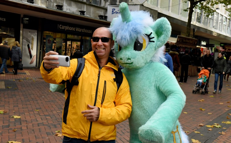 Ian Taylor on a walkabout as he his stopped for a selfie from a young man