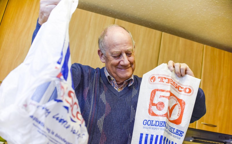 MARTIN MCASKIE, 72, SMILES AT HIS OLD TESCO BAG FROM 1981 WHILST HOLDING A MODERN BAG