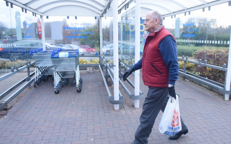 MARTIN MCCASKIE WITH HIS TESCO BAG FROM 1981, IN HIS LOCAL TESCO STORE