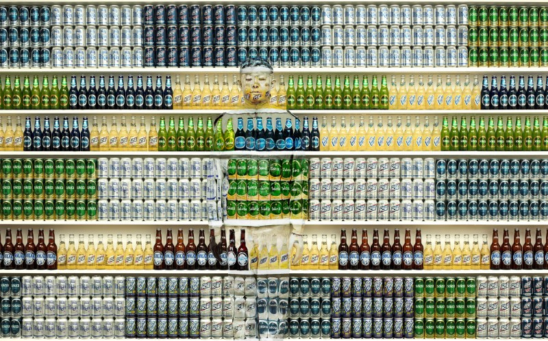 Liu Bolin disappears into the backdrop of canned and bottled beers