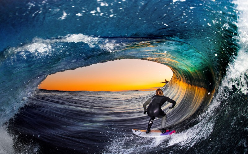 One of Leroy's images taken during the day from the inside of the barrel as his friend surfs
