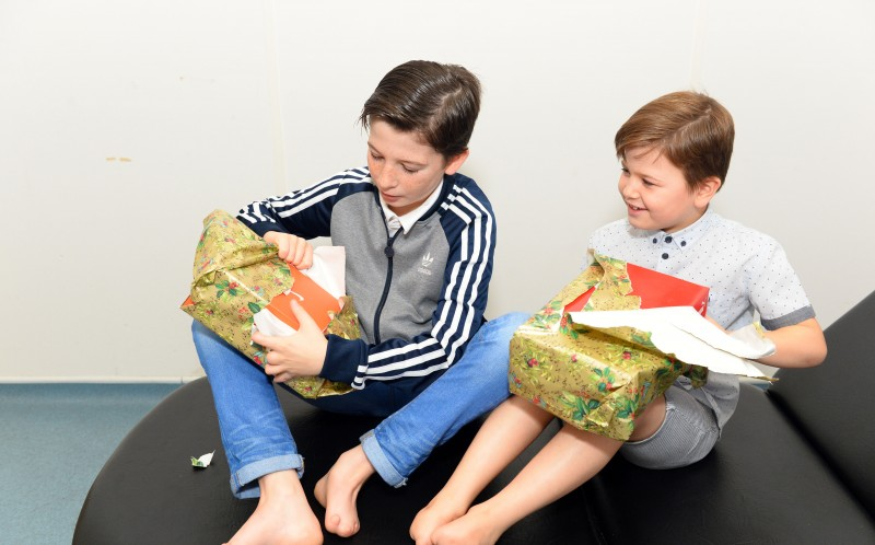 L-R Kian and Callum open their Christmas presents