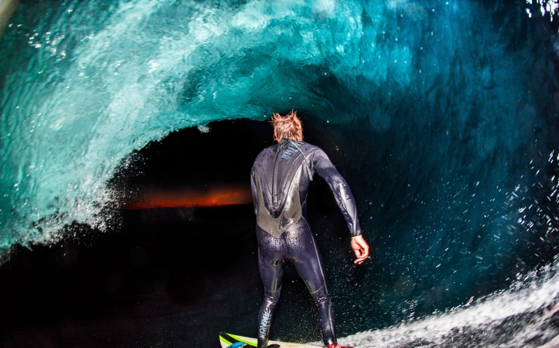 One of Leroys images taken during the night from the inside of the barrel as his friend surfs