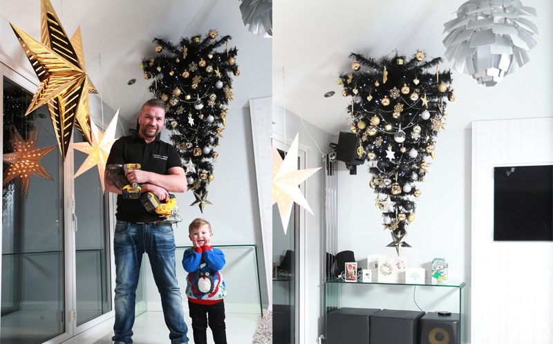 Diy dad child proofs christmas tree by hanging it from
