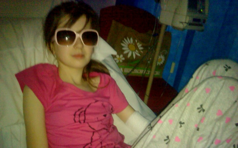 Hollie Cullen in hospital with her sun glasses on
