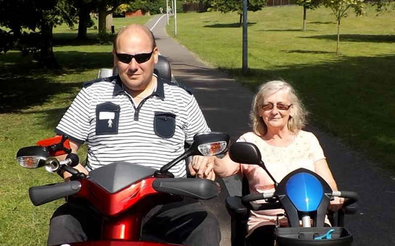 Paul and Carole on their scooters