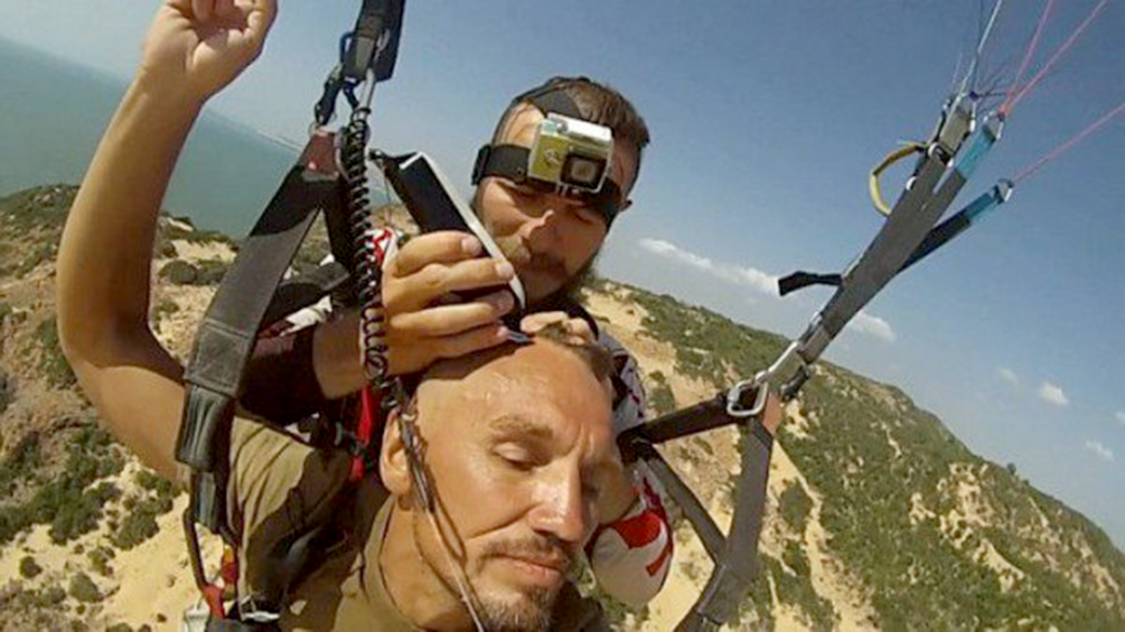 Cutting hair whilst paragliding