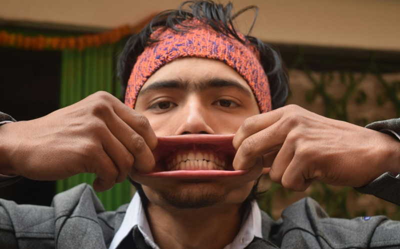 Raja Thapa showing his big mouth