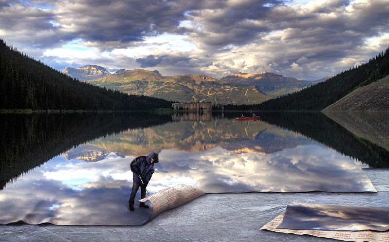 A surreal composite image by Modifeye depecting a man laying down a lak as if it was carpet