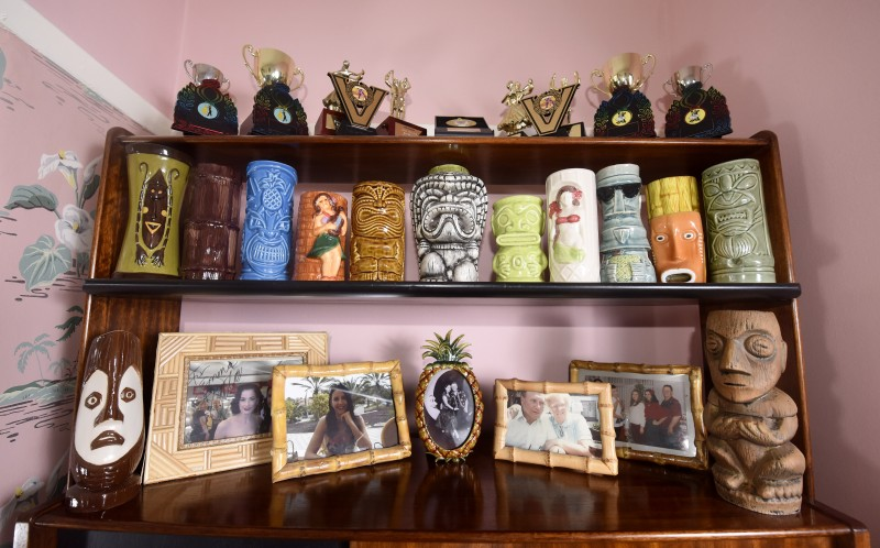 Shelves with Tiki-inspired vases and statues