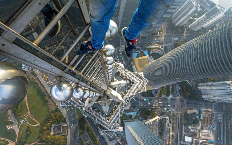 A daredevil sits on top of Jin Mao Tower in Shanghai