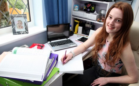 PIC BY SOFIA BOUZIDI/CATERS NEWS - (Pictured: Lucy Pearce who suffers from Dermatographia which means her skin swells when a small amount of preassure is applied) - Meet the student whose rare condition means she can write on her skin just like a notepad and even uses it to revise for exams. Lucy Pearce, 16, from Sheffield, South Yorks, has such sensitive skin that even the lightest scratch causes large red hives to appear within two minutes. She has dermatographia, which is a histamine release to the surface of the skin that causes an allergic reaction - this makes the irritated area swell and itch before vanishing half an hour later. Since her first flare-up three years ago the dentistry and Spanish student has utilised her unusual symptoms to help her revise for exams and even uses it to remember shopping lists. SEE CATERS COPY.