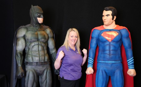PIC BY MIKEY JONES / CATERS NEWS - (PICTURED: Rose with Superman and Batman ) - Is it a bird? Is it a plane? No, its Superman and Batman immortalised in CAKE. Ahead of the long-awaited DC Comic movie Batman v Superman: Dawn of Justice, baker Rose Macefield spent a mammoth 300 HOURS carefully crafting the 6ft 6ins crime fighters for Cake International at Birminghams NEC. The hunky heroes contain a teeth-itching 60 kilos of sugar paste with rice crispies centre built around a metal and plastic frame with an airbrushed finish. Mum-of-four Rose, 42, said: Both Batman and Superman have a universal appeal  theyre really popular with little kids through to grown-ups. SEE CATERS COPY