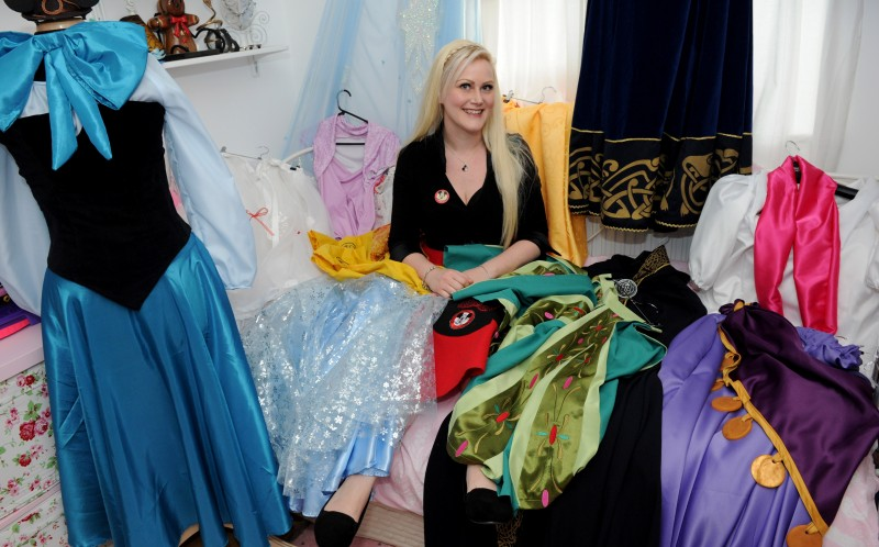 Jesse surrounded by some of her Disney outfits