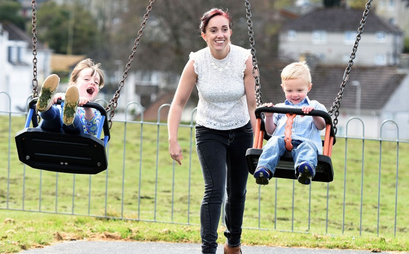 Faye Wilkins plays with her two children George aged 2 and Molly aged 7 at a park near their home
