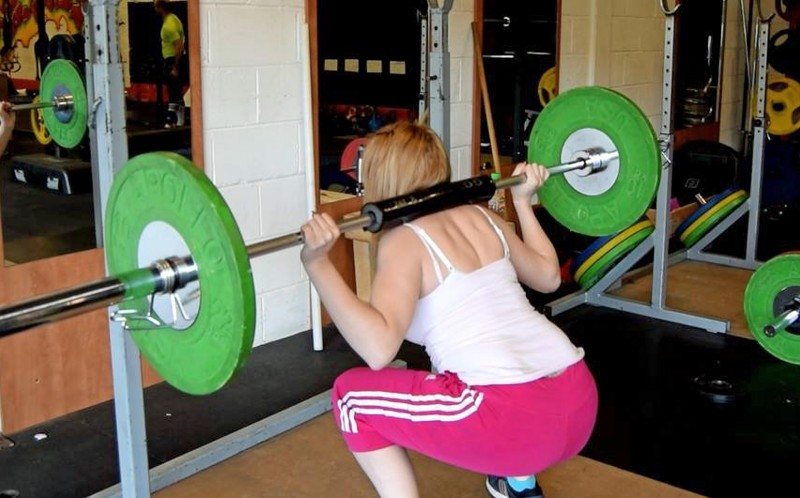 Lauren Davies lifting weights