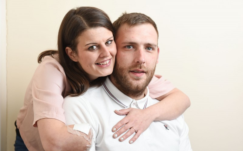 LISA HOLDEN, 31, WITH HER FIANCE KIRK MOUNT, 28
