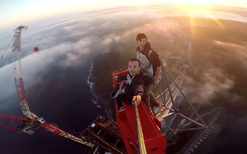Pavel Smirnov and his friend on top of the top of the Yavuz Sultan Selim Bridge