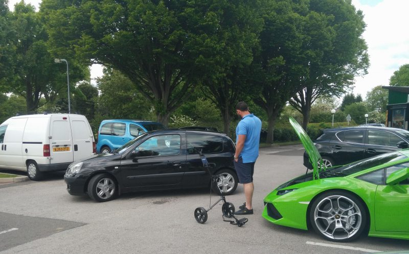 The Lamborghini owner giving the clubs to his friend to take away in a Clio