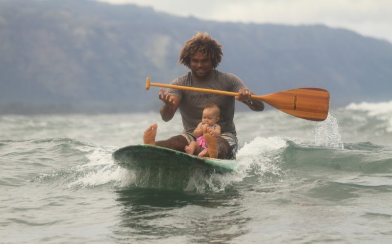 SERGIO LIMA / CATERS NEWS - Nine-month-old nipper Hadassah Sage Lima caught her first wave with her dad Sergio, 29, aged four months. Now the pair are out tearing up the waves every day on the north shore of Oahu.Their daring stunts include Sergio surfing with a delighted Hadassah carefully balanced on his hand. With mum Carly, 29, surfing until she was 38 weeks pregnant, Hadassah fell in love with the water sport when she was still in the womb. SEE CATERS COPY