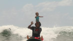 SERGIO LIMA / CATERS NEWS -  Sergio Lima started taking his daughter surfing with him when she was four months old.