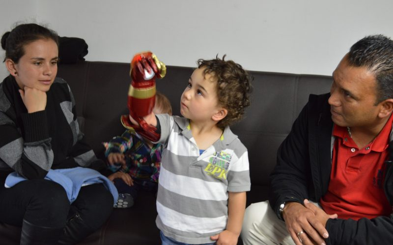 PICTURED: JOSE VELEZ WITH IRON MAN PROSTHETIC AND DAD, PLUS DOCTOR CHRISTIAN SILVA
