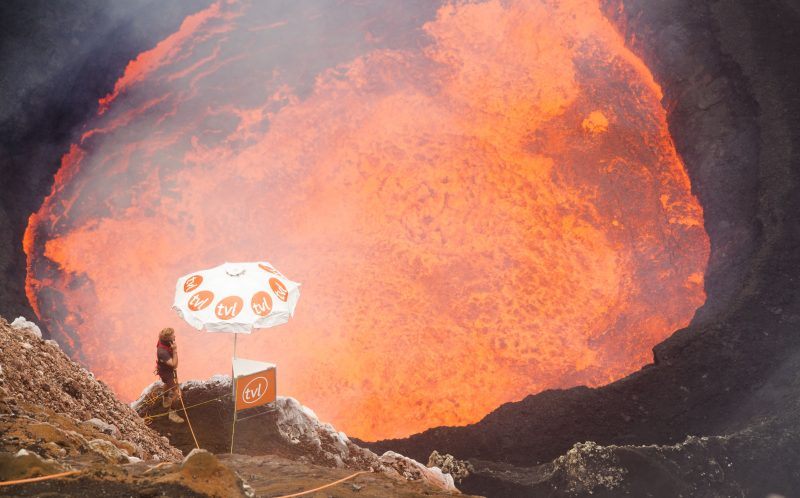 Chris Horsley, 24, from Ormskirk, Lancashire on his phone in the mouth of an active volcano.