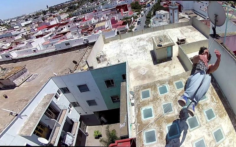 KHALID TENNI / CATERS NEWS - Khalid Tenni back-flips on a rooftop.