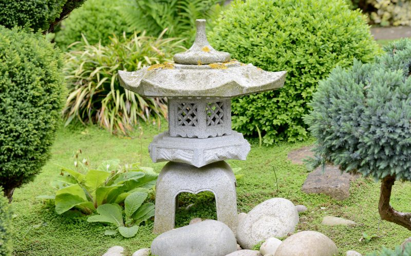 The back garden of couple's ex-council cottage in Welbourn, Lincs, has been completely transformed into an incredible Asian oasis.