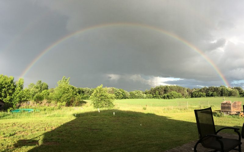 JESSICA SCHINKE / CATERS NEWS - Amazing images show how a family was able to capture the end of the rainbow in Chippewa, Wisconsin, USA.