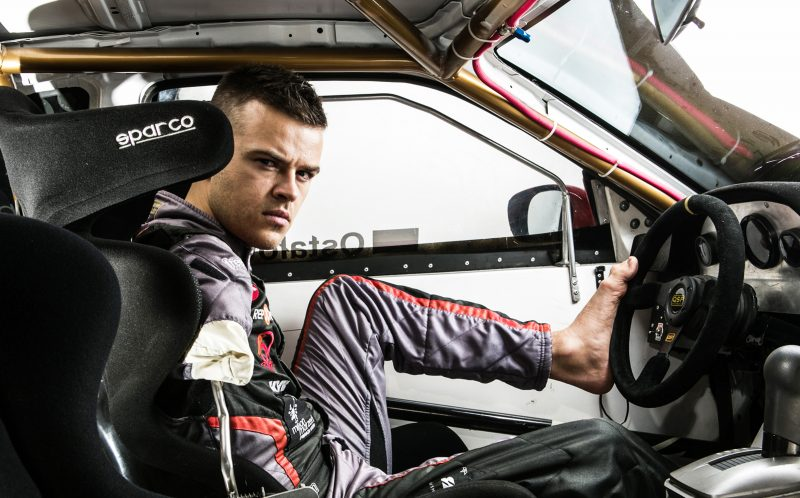 PIC BY MIKOLAJ MIKOLAJCZJK/BARTOSZ OSTALOWSKI/CATERS NEWS - (PICTURED: Bartek Ostalowski poses for a photo in his racing car.) - This incredible Polish petrol head is aiming to become drifting King of Europe despite having lost both his arms. A horrific accident nine years ago meant Bartek Ostalowski, now 29, had to have both his arms amputated. It was a devastating time for the young man, who had given everything up until that point to become a racing driver. But instead of staying down, Bartek set his mind to the task of learning to race using only his feet. After three tough years, he finally became the first person with no arms ever to gain a full international racing licence. SEE CATERS COPY.