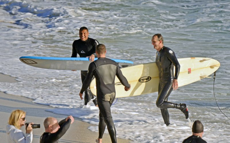 RICHARD KNOPPERT/ CATERS NEWS -  The lucky surfers on the beach after the shark sighti
